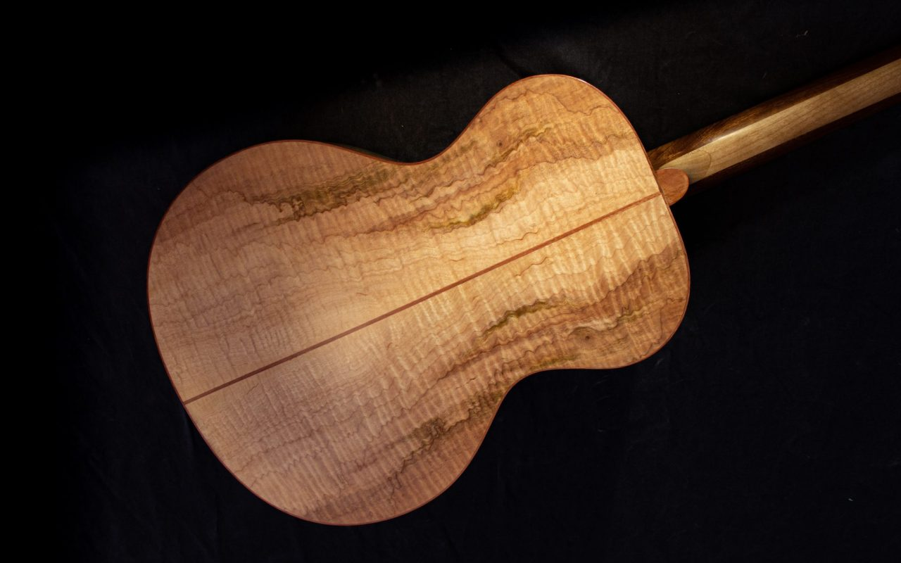 Flamed arched laminated back